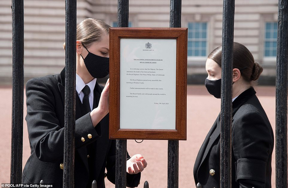 An official notice announcing the death of Britain's Prince Philip, Duke of Edinburgh is placed on the gates of Buckingham Palace in central London
