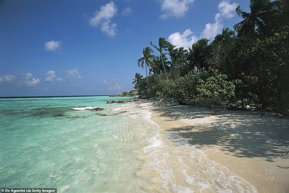 The tiny island of Makunudhoo (pictured) is 15 miles long, three miles wide and one of the most remote in the Maldives