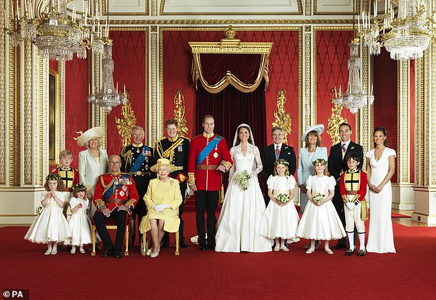 The Queen and the Duke of Edinburgh pose for a family photo after William and Kate's wedding on April 29, 2011