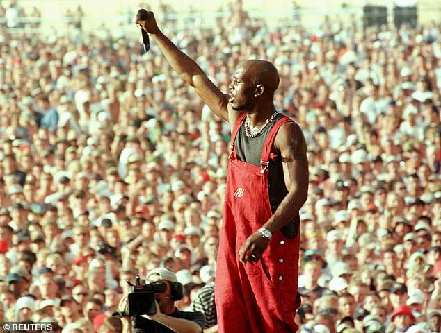 Legendary: He remains the only rapper to have had his first five albums debut at No. 1, beating rap giants including Jay-Z, Kanye West, and Eminem (pictured above at 1999's Woodstock)