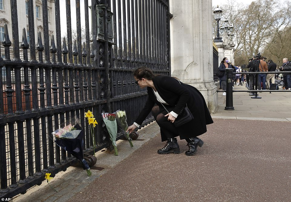 The mood was sombre outside Buckingham Palace this afternoon, as floral tributes were left at the gates