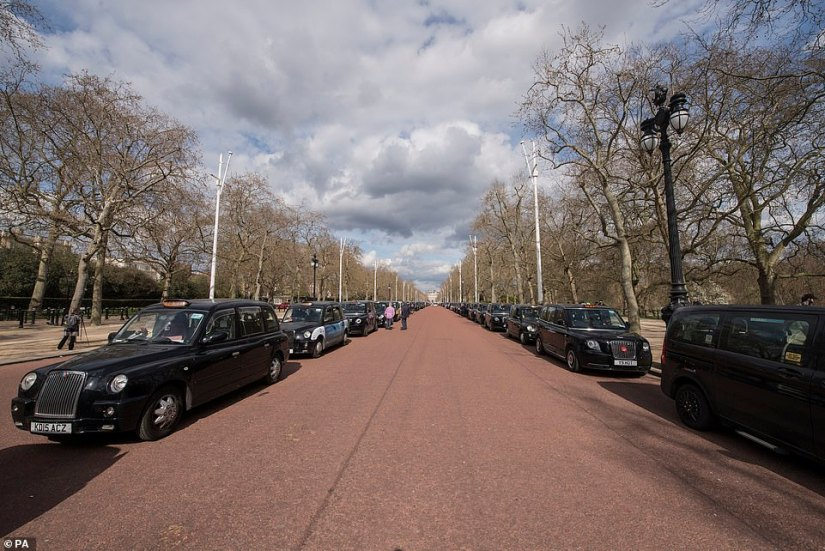 Dozens of taxi drivers lined both sides of The Mall shortly after Prince Philip's death was announced by Buckingham Palace