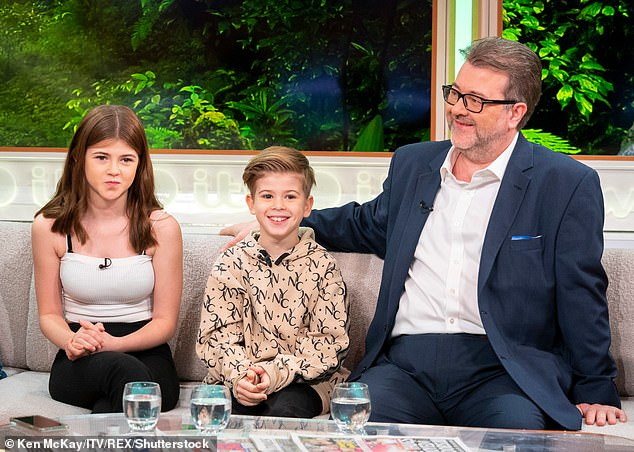 'Scary':Darcey was asked by the interviewer whether it was 'scary' seeing her father in hospital, to which she said: 'I mean it's not really scary, it looks scary. It's just scary in the way of thinking we might lose him.' (pictured together in 2019)