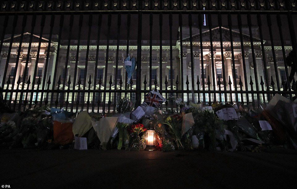 Floral tributes and candles are left outside Buckingham Palace following the announcement of the death of the Duke of Edinburgh