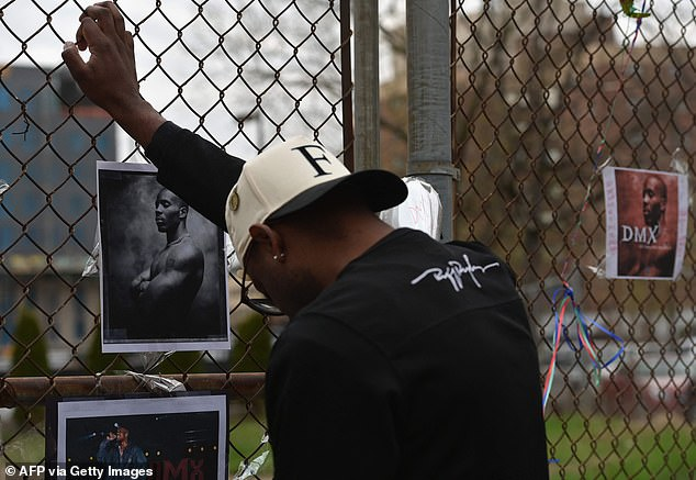 A makeshift memorial grew on Friday after news of DMX's death spread. Mourners paid their respects and placed memorabilia outside the White Plains, New York, hospital where he died