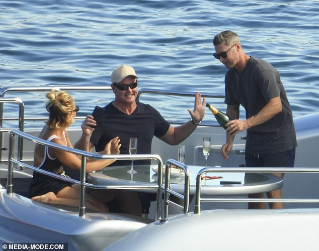 Casual: For the casual day out, Michael wore a pair of navy sports shorts, a black T-shirt and black sunglasses