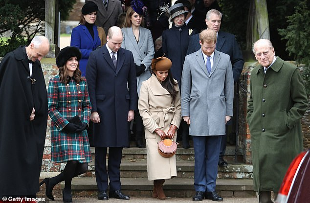 The Duke of Edinburgh, right, with members of the Royal Family including Princess Eugenie, Princess Beatrice (behind) and the Cambridges and Sussexes (front row)