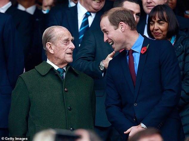 Prince Phillip and Prince William pictured enjoying the preparations for the 2015 Rugby World Cup Final between New Zealand and Australia at Twickenham Stadium on October 31, 2015 in London