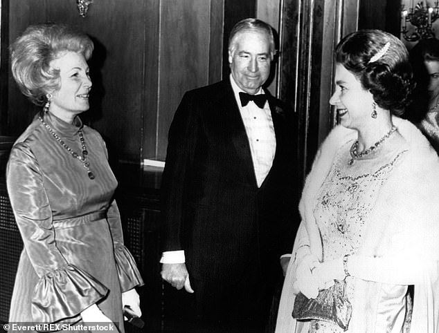 Walter Annenberg with his wife Lee (left) and the Queen (right) in 1973 - four years after making the 'gorilla' joke