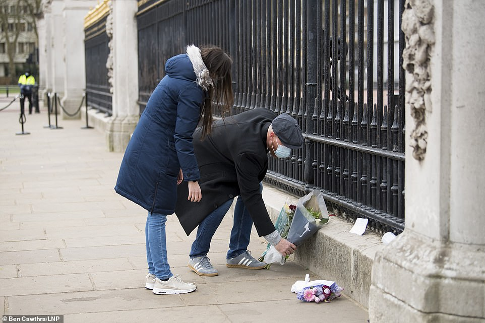 Mourners came to Buckingham Palace through the night and as dawn broke to lay flowers for Prince Philip, who died yesterday aged 99
