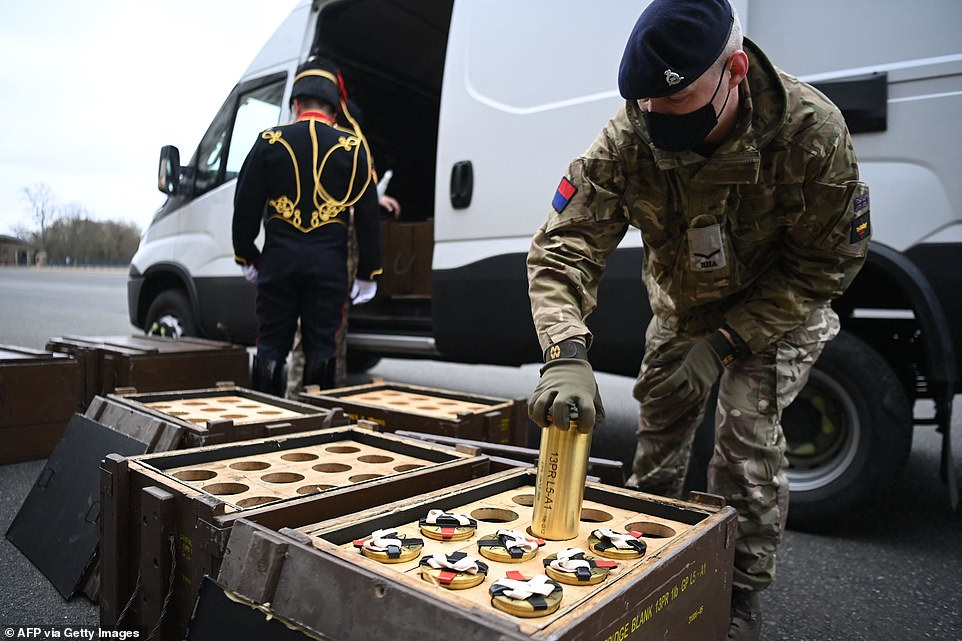 Members of The Kings Troop Royal Horse Artillery place empty shells into boxes in advance of a gun salute to commemorate the death of Britain's Prince Philip, Duke of Edinburgh, at the Parade Ground, Woolwich Barracks