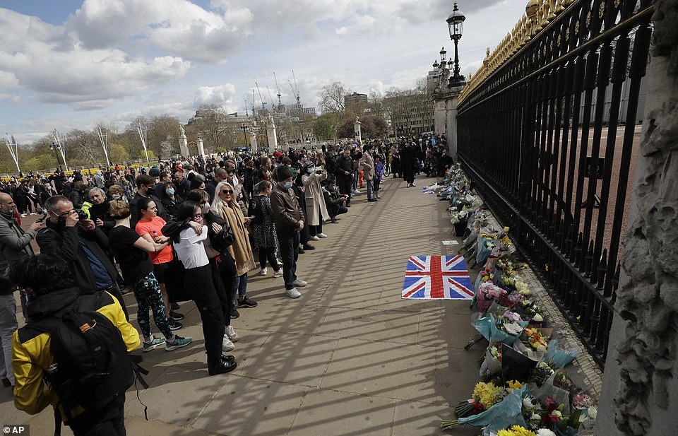 People stood in masks, two metres apart to hug and remember the Queen's husband, who dedicated his life to the country