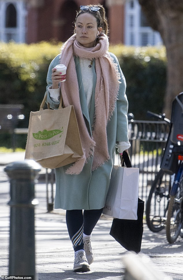 Actress-turned-director Olivia WIlde cut a lonely figure while shopping in Barnes, southwest London last week