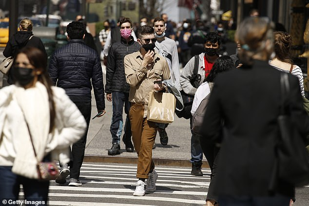 Meanwhile, Dr Cyrus Shahpar, the White House COVID-19 data director for COVID, said on Twitter that the United States has administered more than 4.6 million doses of the vaccine.  People are seen wearing masks in New York on Saturday