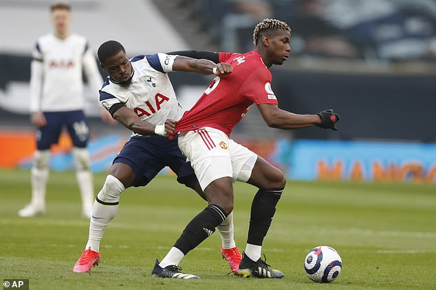 Pogba had tangled with Serge Aurier (left) in the early stages in London but was not punished