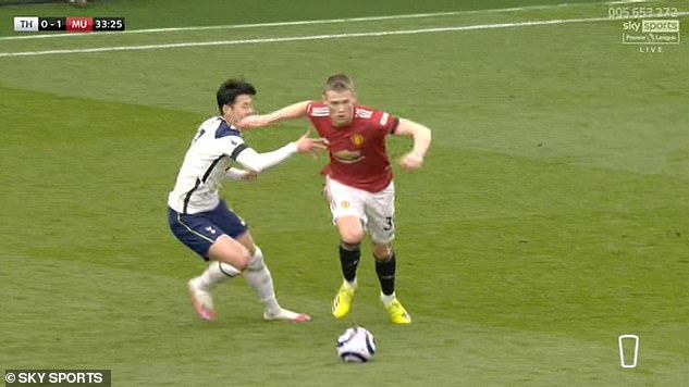 Son Heung-min (left) went to ground before Edinson Cavani's disallowed goal on Sunday, having been caught by Scott McTominay (right) during the build up