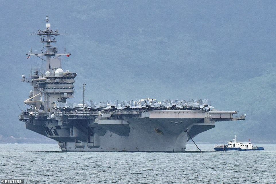 The microchip idea came after the USS Theodore Roosevelt (pictured) saw 1,271 infections