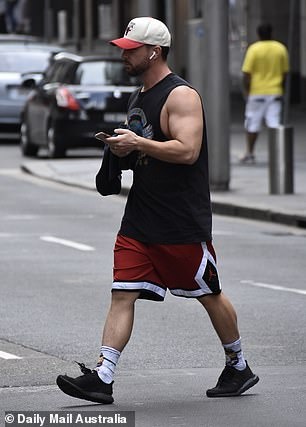 Athletic:He completed his outfit with red basketball shorts