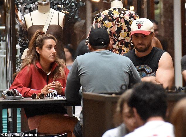 Is everything okay? A glum-looking Jason Engler (right) was comforted by his Married At First Sight co-stars Johnny Balbuziente (centre) and Kerry Knight (left) during filming in November