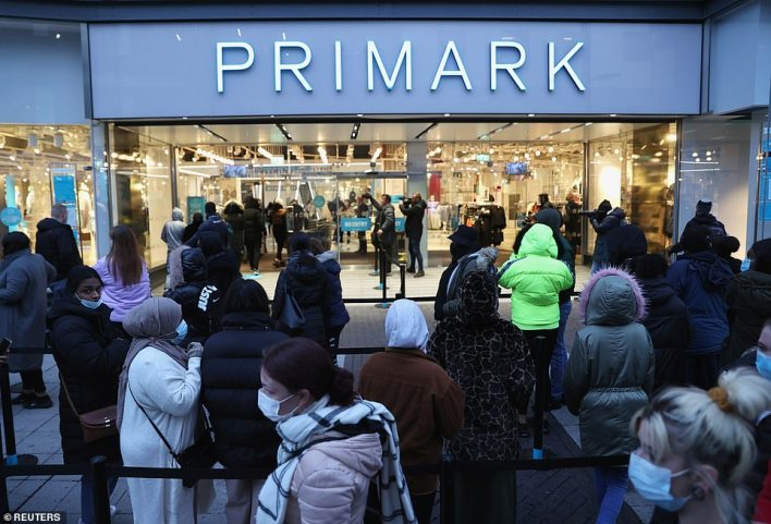 Customers queue this morning outside Primark in Birmingham city centre on 'the Glorious Twelfth' - when non-essential retail reopens
