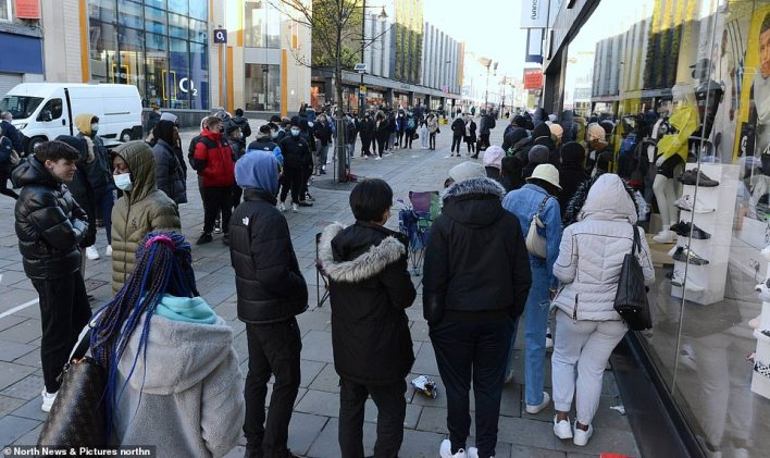 Shoppers queue early to enter the JD Sports store in Newcastle city centre on the day lockdown restrictions ease further across England