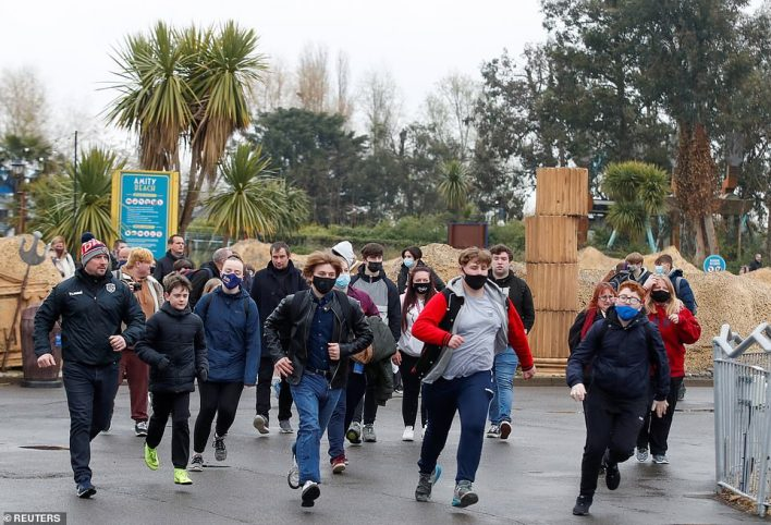 People run through Thorpe Park today in order to get on the best rides after theme parks were allowed to reopen in England