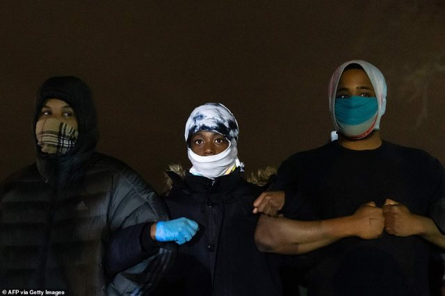Protestors link arms in a show of strength in Brooklyn Center near Minneapolis