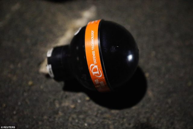 A crowd control munition is seen on the ground outside Brooklyn Center Police department after protests began over the fatal shooting of a man by police