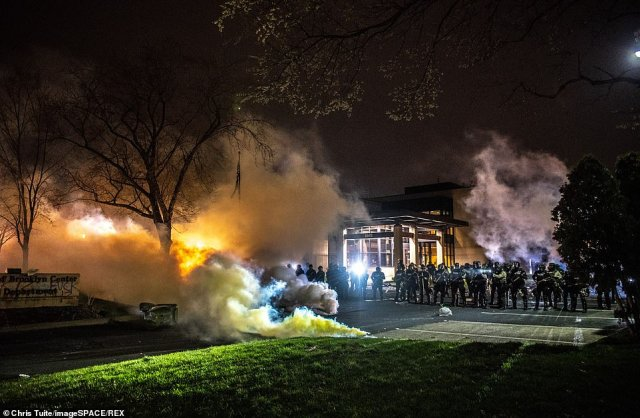 Protestors and City of Brooklyn Center Police Officers clash outside the Brooklyn Center Police Department on Sunday night