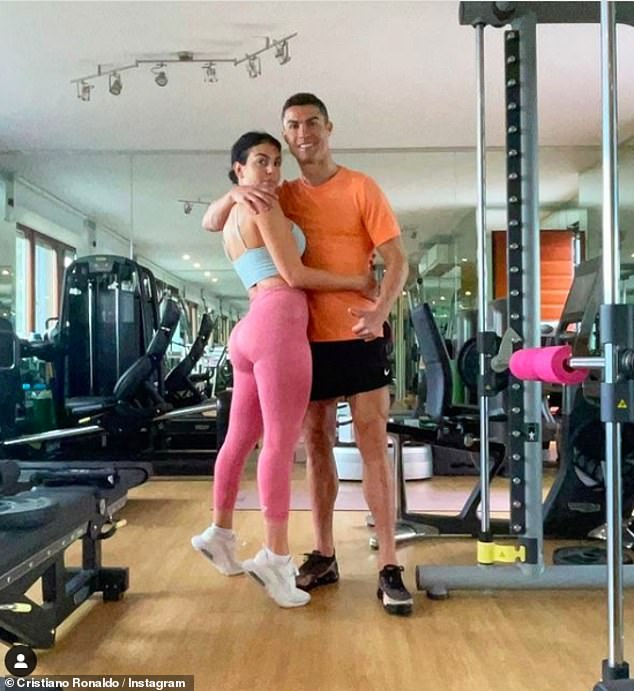 Loved up: Cristiano Ronaldo and Georgina Rodriguez looked as loved up as ever as they donned work out gear and posed for a gym snap on Instagram on Monday