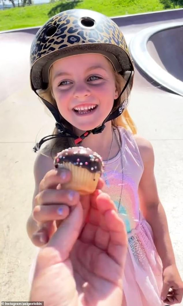 Yum! Another video taken that day shows Paige doing her thing at the skate park before finishing off with a cupcake from her mom