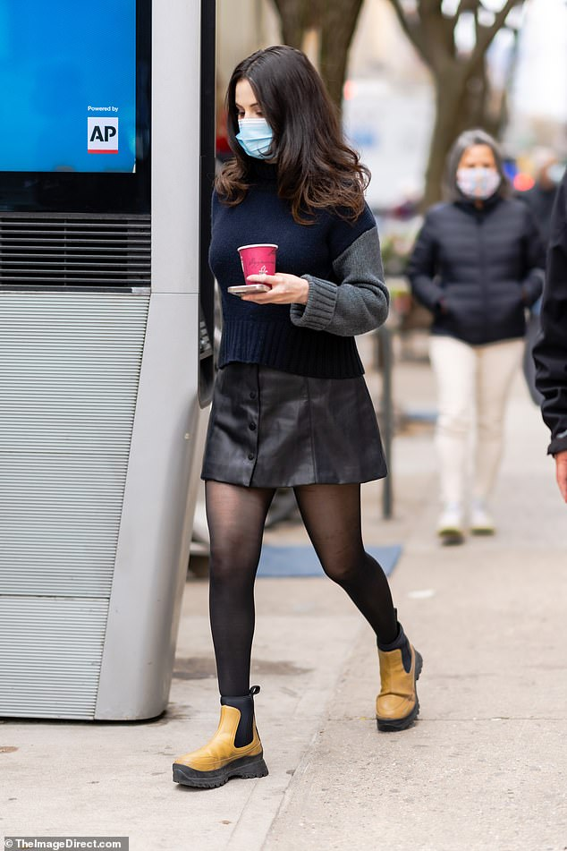 Chic in the city: The 28-year-old actress wore a trendy leather skirt with a sweater as she worked her way through hair and makeup before another busy day of filming.