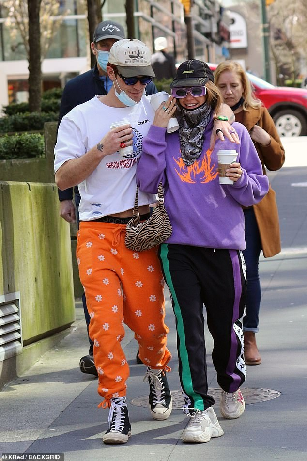 Mandatory:The half-Samoan, half-Kiwi 23-year-old (L) and the 27-year-old Freedom Model (R) sported colorful athleisure attire and wore face coverings around their chins to drink coffee