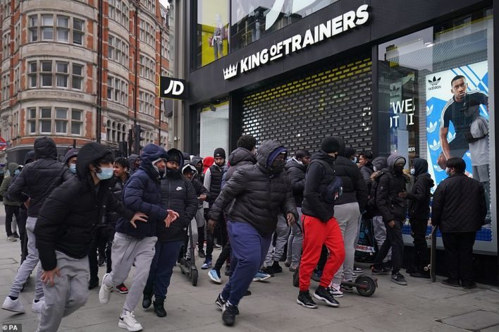 Shoppers sprinted towards JD Sports in Oxford Street in astonishing scenes this morning amid a sale on trainers - many of which are sold on online