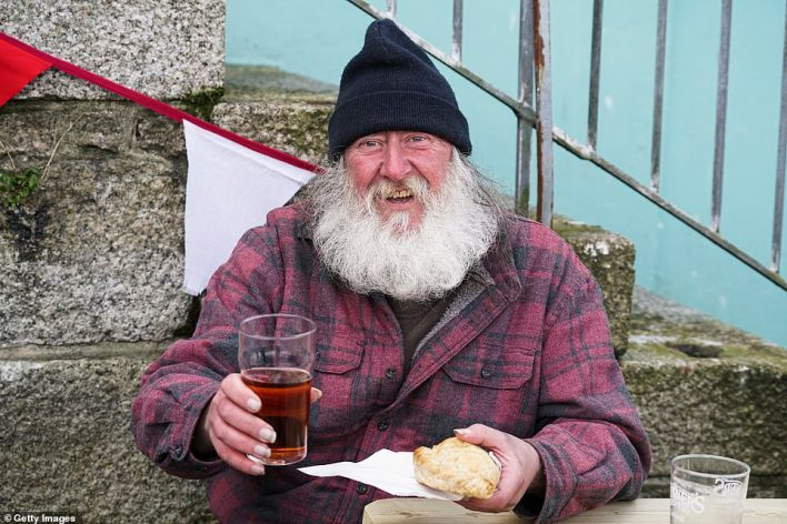 Local man John Renshaw with a pint and a pasty at The Front pub on Custom House Quay in Falmouth