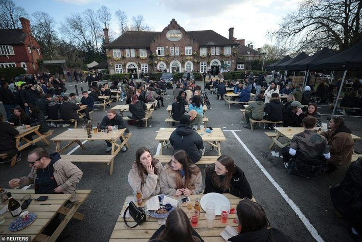 People enjoy their drinks at The Fox on the Hill pub after its reopening toady. The area has a large outdoor seating area created from its car park