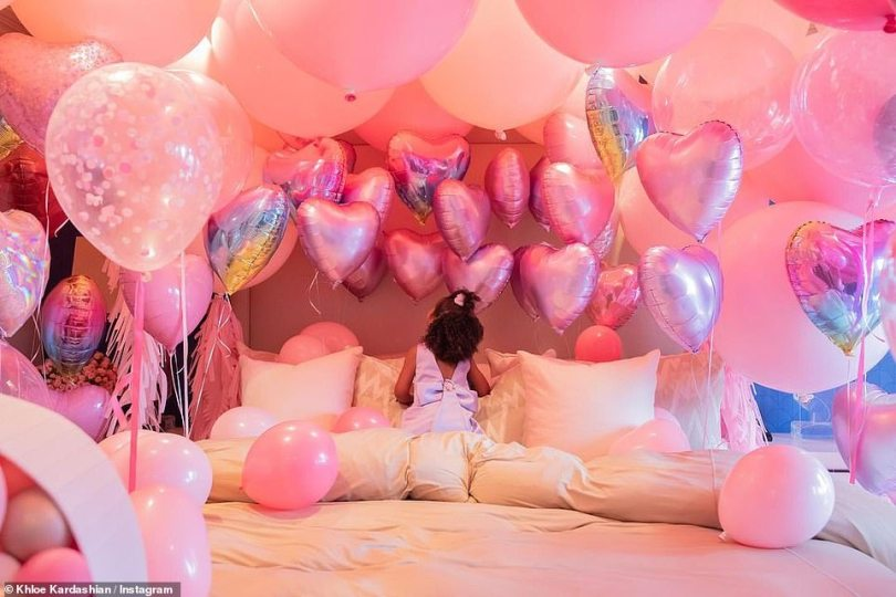 Dream birthday: True took a closer look at her heart shaped balloons above her bed