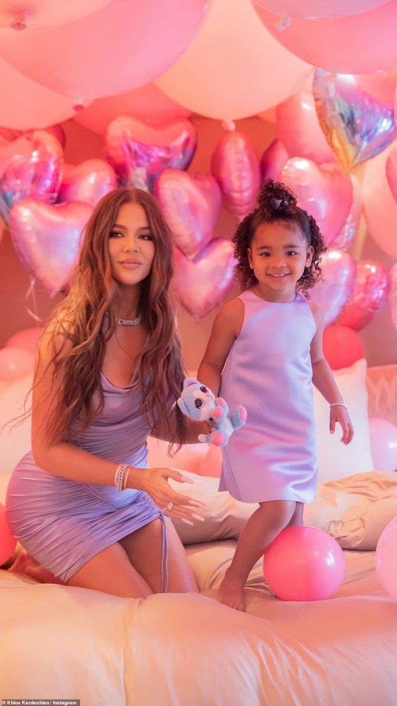 Glowing! Khloe looked stunning in her ruched pastel toned gown, adding diamond jewelry and pink painted nails