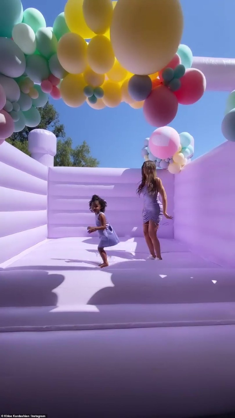 Fun!Khloe jumped around the bounce house with True, as she showed off her birthday festivities look; she looked incredible in a soft purple dress, matching her outfit to her daughter's