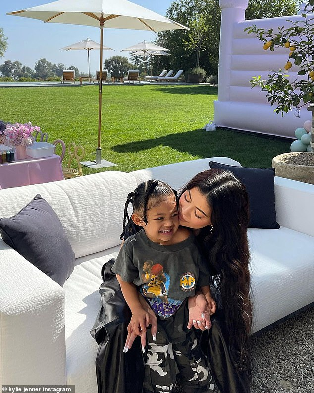 Doting mom: Kylie was by Stormi's side for the afternoon as they had a scaled-back birthday party that was nothing short of spectacular