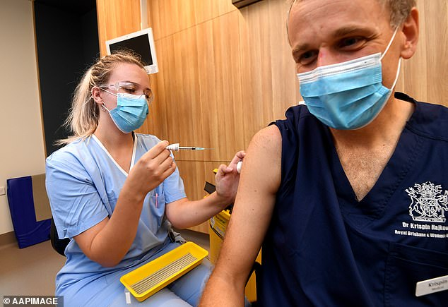 A woman in her 40s has been hospitalised with blood clots reportedly after receiving the AstraZeneca vaccine. Pictured: A doctor receives the jab