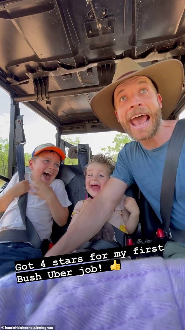 Making memories: Hamish Blake (right), 39, shared a snippet of him being a 'Bush Uber' driver for the first time with their children - Sonny (left), six, and Rudy (centre), three - in the backseat
