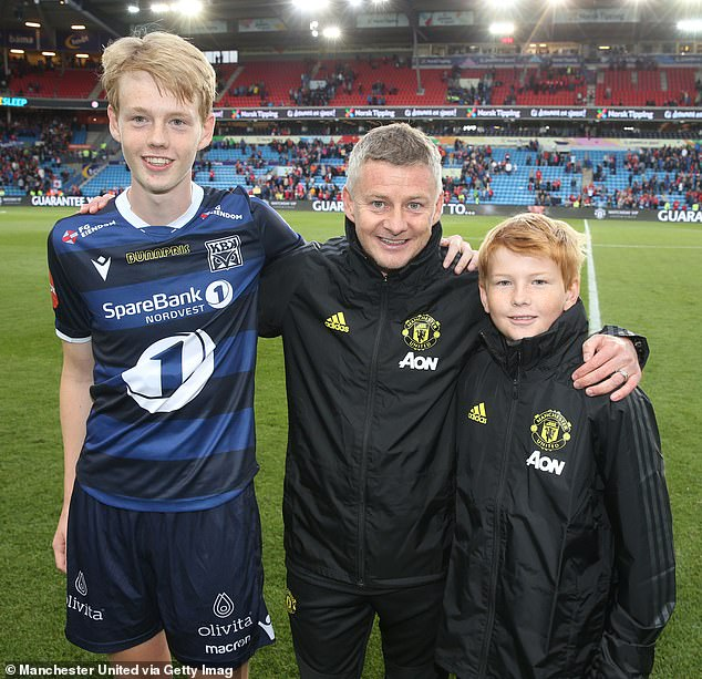 Noah Solskjaer (left), pictured with his father Ole Gunnar Solskjaer and brother Elijah Solskjaer in 2019, has become embroiled in his dad's row with Jose Mourinho