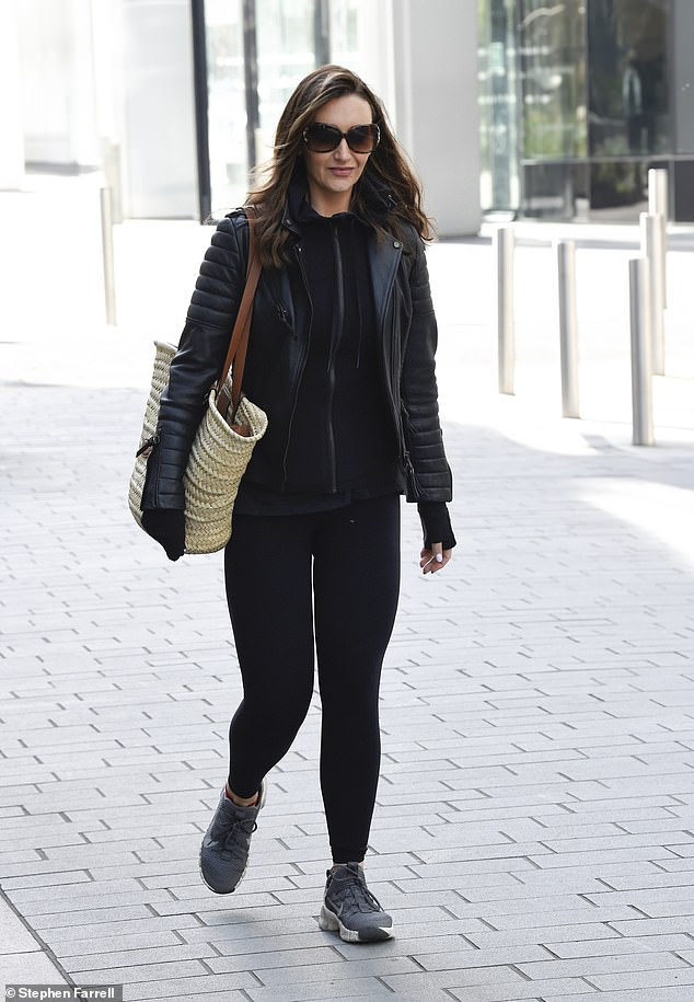 Gym time:The former Strictly competitor – whose nails were painted a crisp shade of white - teamed her leggings and top with a pair of black trainers