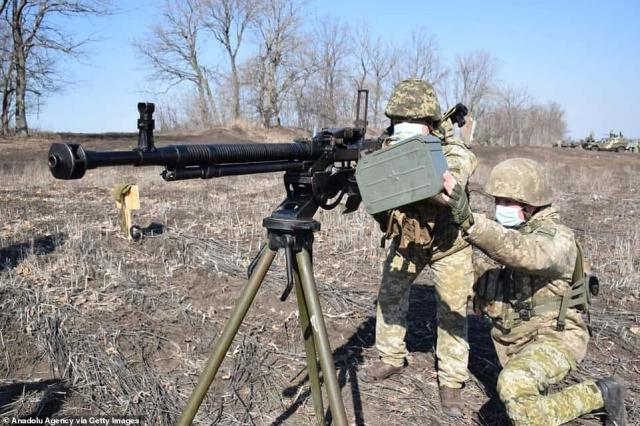 Ukrainian soldiers train using a heavy machine gun near the border with Russia amid increasing tensions between the two countries which has seen Moscow rapidly increase troop numbers