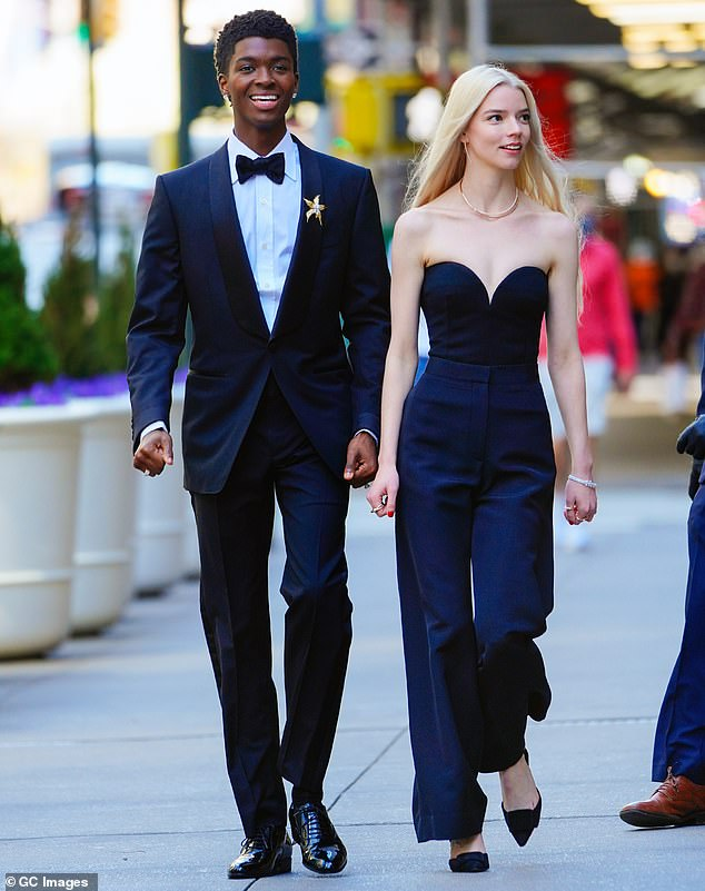 Good looking people in Manhattan:The two were playing the part of a well attired couple as the walked through the busy streets with a camera crew behind them