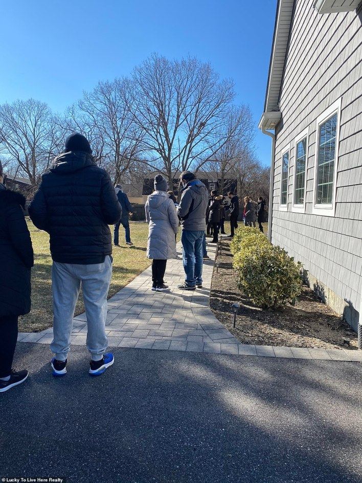 Agent Christina F. Tabacco-Weber told DailyMail.com prices have increased across the whole of Long Island in the last year while there are around 50 percent fewer homes on the market. A line of people wait to view an open house