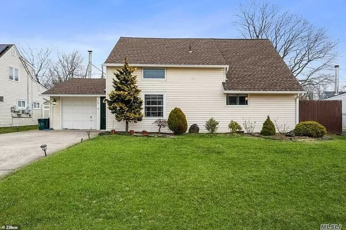 WESTBURY, LONG ISLAND: This four-bedroom home described as an 'expanded ranch' in Hedge Lane sold for $585,000 in January - more than $15,000 over its asking price of $569,900