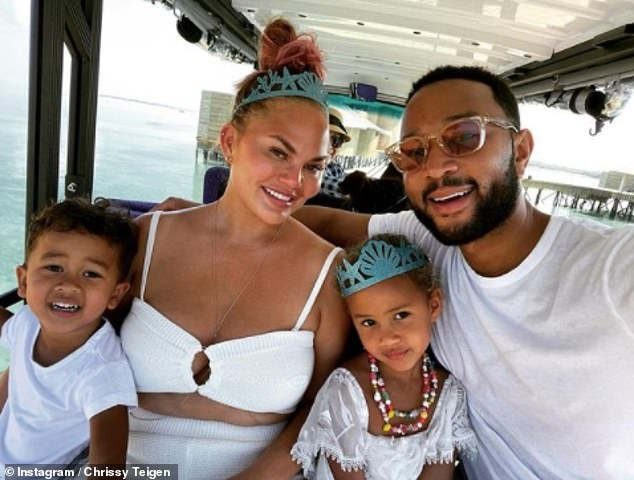 Happy: Chrissy Teigen posed for a sweet family photo with husband John Legend, daughter Luna, four, and son Miles, two, during their tropical getaway on Wednesday