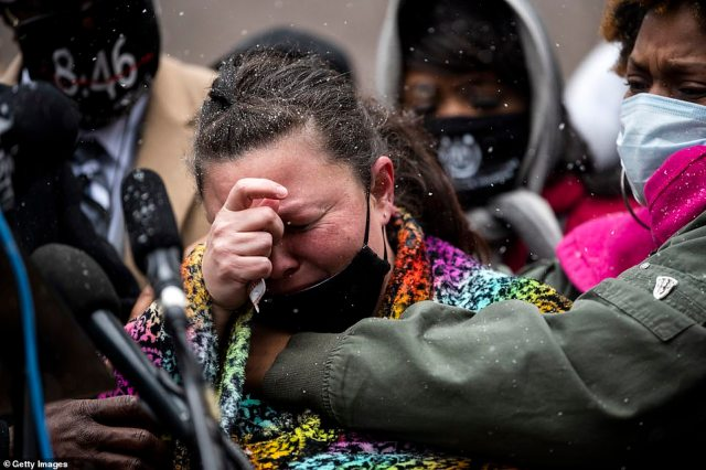 Naisha Wright embraces Katie Wright, the mother of Daunte Wright, as she speaks during a press conference outside the Hennepin County Government Center on April 13